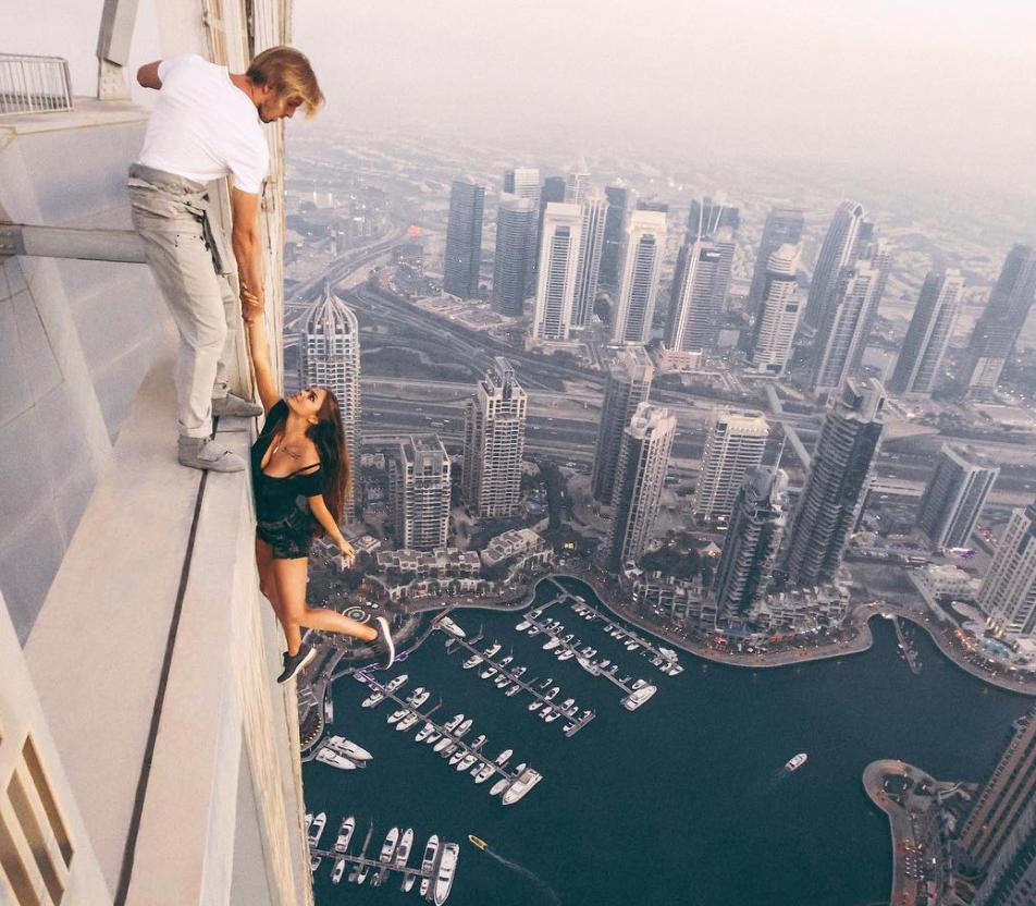 Viki Odintcova hangs from a 73 story building, Dubai. | V. Odintcova