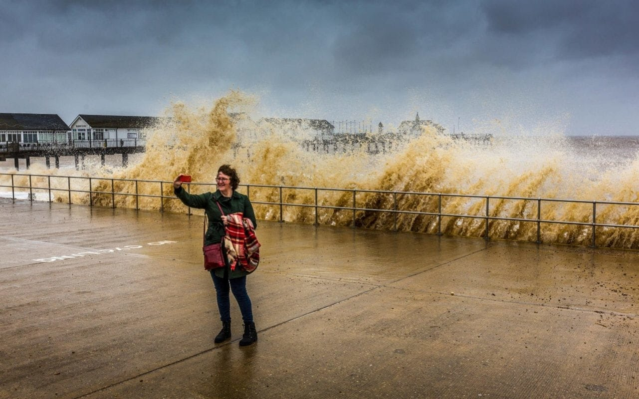 A selfie in front of rough seas at Southwold Pier