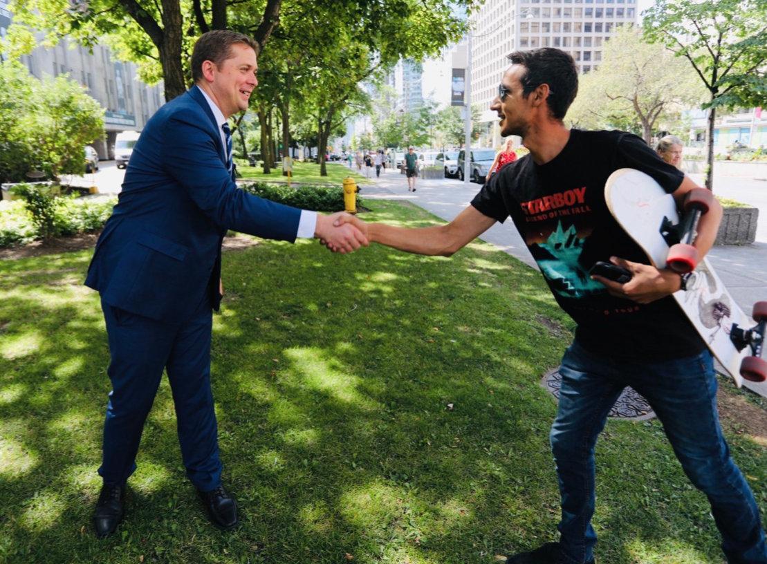 Staged sidewalk handshake in Toronto